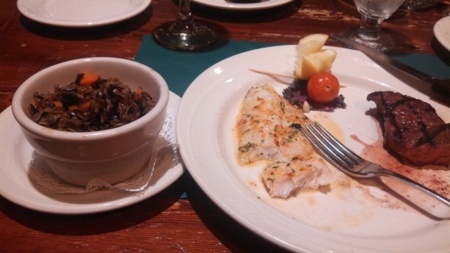the food was very good. This is Walleye Pike and steak, with a side of wild rice. The Caesar salad was consumed prior to the photo session.