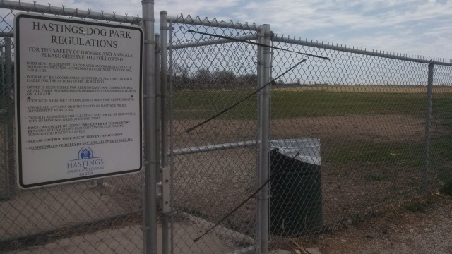 This is the entrance to the many-acre fenced field that is the dog park in