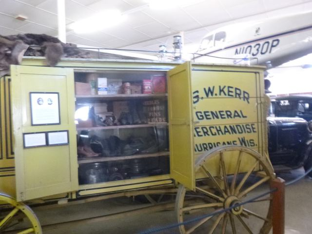 Peddler's wagon. My mom said she could remember a man coming by with a wagon like this.