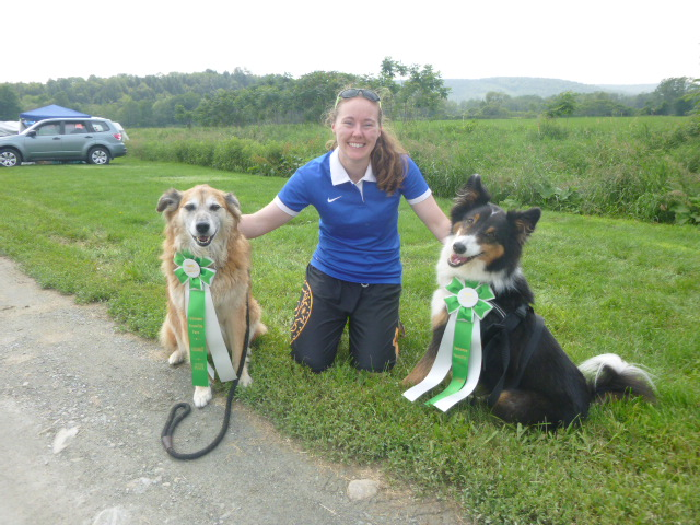 Katie, and Jonah and Chico with their ribbons.